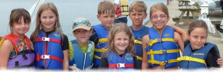 Happy kids learn to sail at Neryc summer sail camp